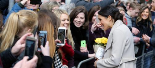 Meghan Markle interacting with women during her visit to Belfast. [Image credit – Northern Ireland Office, Wikimedia Commons]