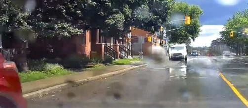 A Canadian van driver was fired after he was caught on video deliberately splashing pedestrians. [Image Saif Khan/YouTube]