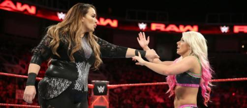 There may be more than just an on-television feud between WWE stars Nia Jax (left) and Alexa Bliss (right). - [WWE / YouTube screencap]