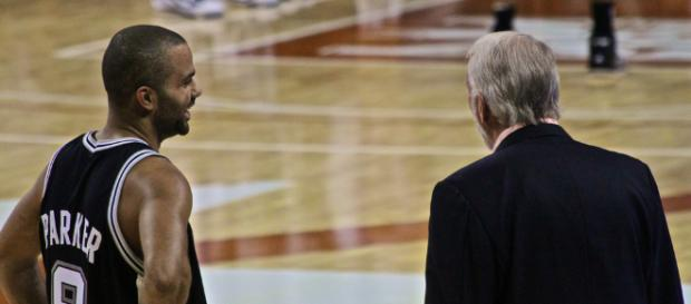 Tony Parker with Spurs coach Gregg Popovich. - [aaronisnotcool / Flickr]