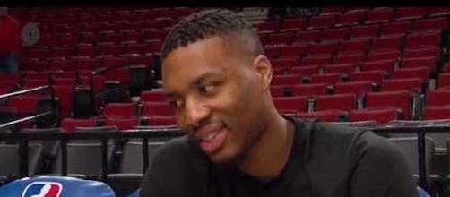 NBA star Damian Lillard recently told reporters he's not unhappy playing in Portland. - [Portland Trail Blazers / YouTube screencap]