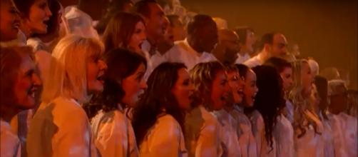 The people's vote and divine intervention pulled Angel City Chorale to the semifinals on 'America's Got Talent.' [Image Source: AGT - YouTube]