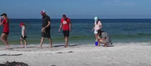 Despite red tide, visitors enjoying Anna Maria Island. [Courtesy – Bradenton Herald, YouTube]