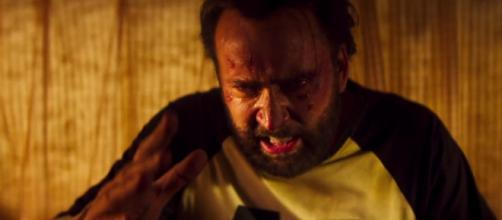 Nicolas Cage vows to hunt down the creepy killer in 'Mandy.' [Image Source: RLJE - YouTube]