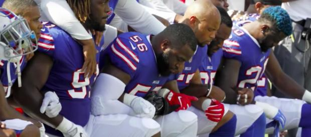 The NFL is working with the players association to come up with a new national anthem policy. (image source: CBS Evening News/YouTube)