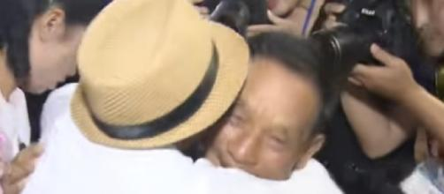 Tears of joy: North & South Korean families separated over 6 decades ago reunite. [Image courtesy – RT, YouTube video]