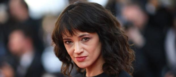 Asia Argento in bed with underage co-star (Image via RT.com/Twitter)