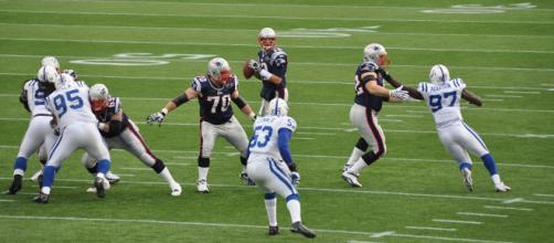 File:Tom Brady and his offensive line.jpg - (Image via fantasy football/Wikimedia Commons - wikimedia.org)