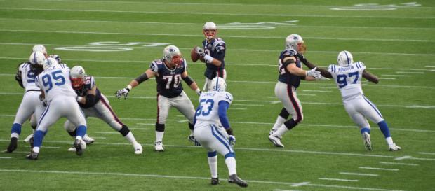 File:Tom Brady and his offensive line.jpg - (Image via fantasy football/Wikimedia Commons - wikimedia.org)