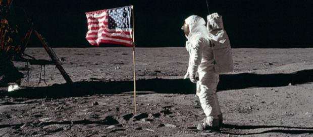 Buzz Aldrin salutes the American Flag. [Image Source: NASA]