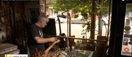Rick Kelly of Carmine Street Guitars repurposes wood of NewYork's history into guitars for stellar artists. [Image source:CBSThisMorning-YouTube]