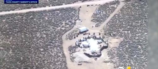 The New Mexico remote compound were 11 children and 5 adults were found. [Image CBS Denver/YouTube]