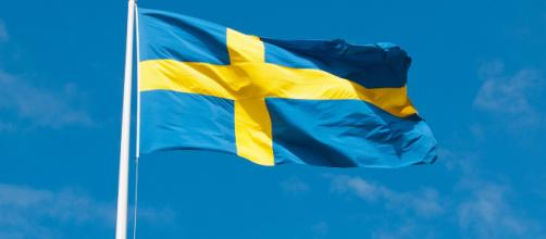 The Swedish Flag, often associated with political events. [Image via Unif - Pixabay]