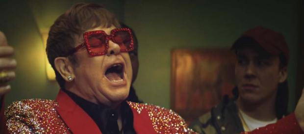 Rumours are going around that Elton John will appear in the John Lewis Christmas advert for 2018. [Image Snickers UK/YouTube]