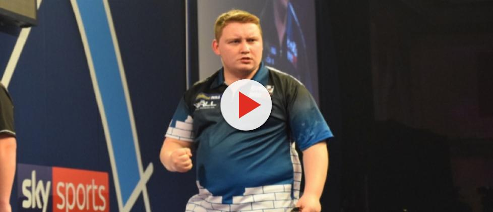 Darts star Schindler shines in front of home crowd