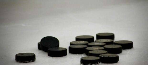 A group of hockey pucks on ice, much like the ones used by Zetterberg. [Image via StrategicWebDesign_Net - Pixabay]