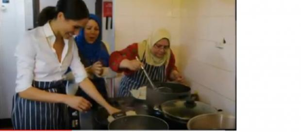 Meghan Markle makes secret visits to Grenfell to make cookbook and she's in the kitchen. [Image courtesy- Star magazine YouTube video]