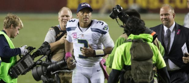 Russell Wilson was under siege all night in their 17-10 Week 2 loss to the Bears. [Image source: Keith Allison - Flckr]