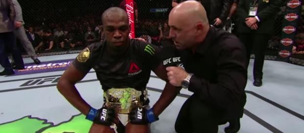 Former UFC champion Jon Jones has received a retroactive 15-month ban by USADA and can return to competition in October. [Image via UFC/YouTube]