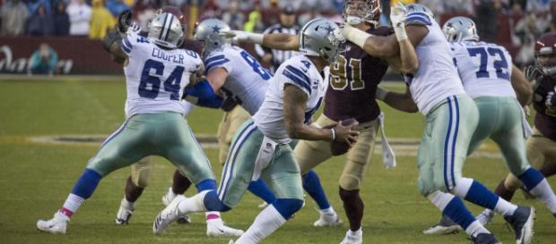 Dallas quarterback Dak Prescott scrambles to return to 2016 form. - [Keith Allison / Flickr]