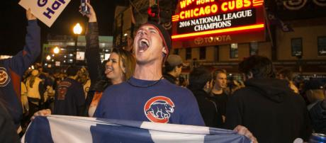 Chicago Cubs fans want to celebrate but the team is holding off. [Image source: nypost - YouTube]