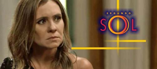 Laureta vê seu capanga de conversa com Luzia e fica furiosa.