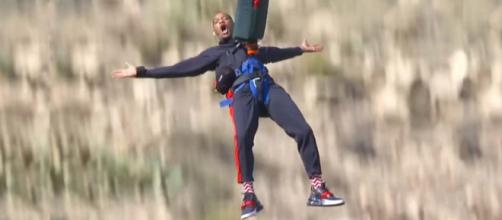 Will Smith was challenged to go bungee jumping over the Grand Canyon from a helicopter for his 50th birthday. [Image Will Smith/YouTube]