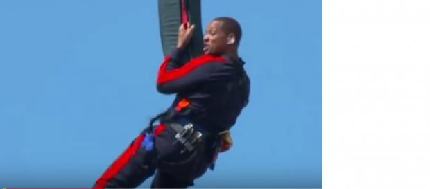 Will Smith Helicopter Bungee Jumps for 50th Birthday Live. [Image courtesy - Daily Pop, E! News YouTube video]