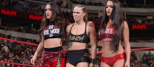 Oddsmakers don't expect the team of Ronda Rousey and The Bella Twins to lose at WWE Super Showdown. [Image via WWE/YouTube]
