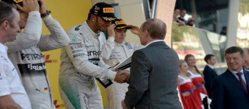 Lewis Hamilton receives his Russian Grand Prix trophy from President Vladimir Putin - Image - Kremlin Ru | Wikimedia