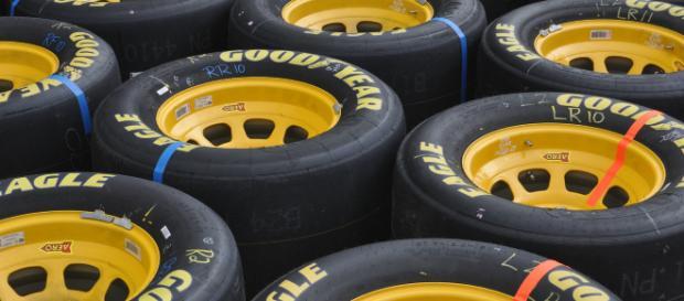A group of NASCAR racing tires. [Image via artbyrandy - Pixabay]