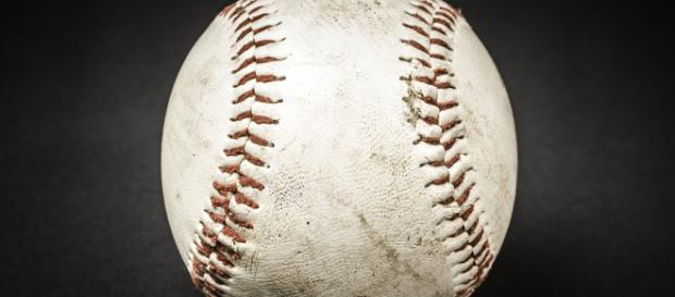 A close-up view of a baseball. [Image Source: Free-Photos - Pixabay]