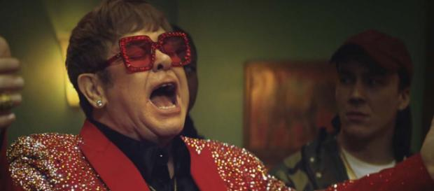 "Elton John has announced the UK dates for his ""Farewell Yellow Brick Road"" world tour. [Image Snickers UK/YouTube]"
