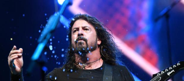 Dave Grohl Chugs Beer, Immediately Falls Off Stage | 104.1 Jack FM - radio.com