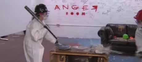 "Dallas ""Anger Room"" is a smashing success at relieving stress. [Image source/CBS News YouTube video]"
