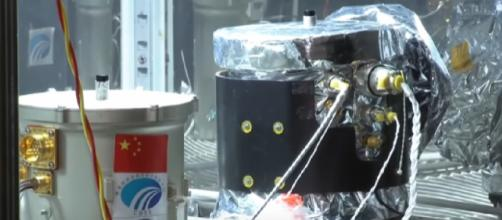 Chang'e-4 conducts experiment with the first cotton sprout on the far side of the Moon. [Image source/SciNews YouTube video]