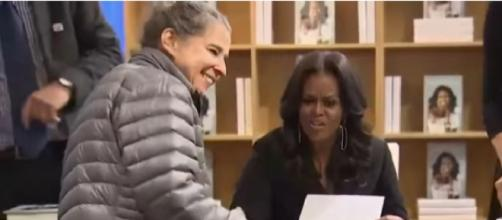 Adults, children line up to meet Michelle Obama on her 'Becoming' book tour in Chicago. [Image source/Global News YouTube video]