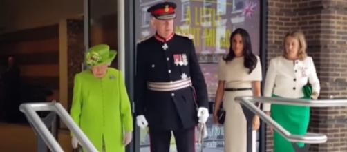 Meghan Markle at her first solo outing with Queen Elizabeth. [Image source/TIME YouTube video]