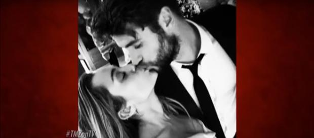 Miley Cyrus, Liam Hemsworth carry before-Christmas wedded bliss into New Year with extended family. [Image source:TMZ-YouTube]