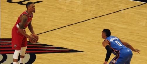 Damian Lillard squaring off against former MVP award winner Russell Westbrook. [image source: James Schumacher- Wikimedia Commons]