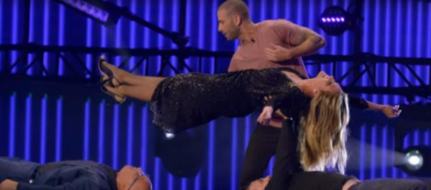 Heidi Klum has more reasons than America's Got Talent: The Champions to make her float in mid-air. [Image source: AGT/YouTube]