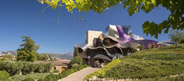 This stunning design by architect Frank O. Gehry is one example of unique and unusual architecture in this world. [Image courtesy Booking.com]