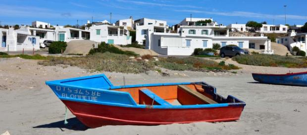 The quaint fishing cottages in Paternoster are white-washed with a pretty blue trim. [Image South African Tourism/Flickr]