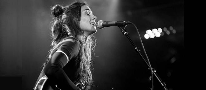 Australian pop singer Amy Shark says two migrants were hiding in her tour bus