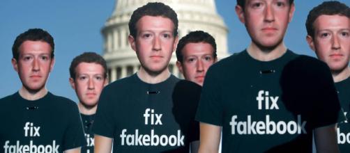 Bonecos de papelão de Zuckerberg em protesto contra o Facebook em frente ao Congresso dos EUA. (Foto: Saul Loeb/AFP)