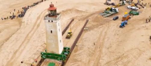 Denmark moves sandswept lighthouse 80 metres on wheels. [Image source/Hot New YouTube video]