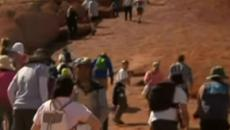 Australia: Tourists flock to the sacred site of Uluru before ban on climbing takes effect