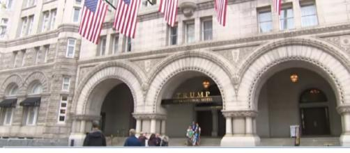 Ethics questions force Trump Organization to put D.C. hotel up for sale. [Image source/CBS Evening News YouTube video]