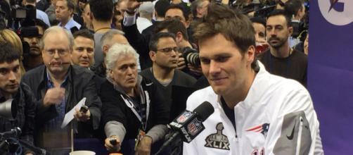Qb Tom Brady at super bowl press conference. [Image Source: WEBN-TV/Flickr]