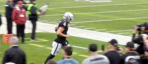 Derek Carr threw three touchdown passes on Sunday. [Image Source: Flickr | Jim Goff]